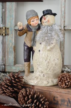 Boy with a snowman figurine made by Ragon House   www.andersonandgrant.com