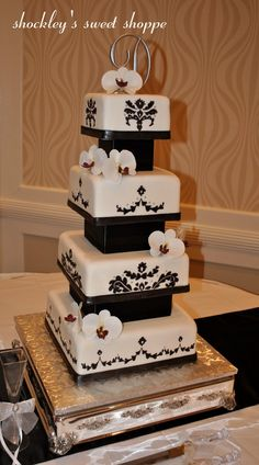 Amazing Fondant Cakes   This amazing 4-tier fondant cake was decorated with hand-painted ...