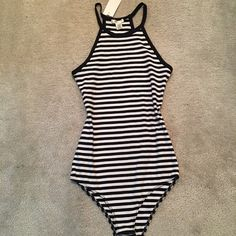 Black and white bodysuit  New beautiful summer bodysuit! Very stretchy material, size L but runs like M size better! You will love it! NOT ZARA BRAND Zara Tops Crop Tops