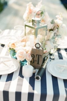 Centerpieces with candle and roses