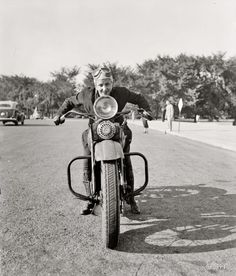 "September 15, 1937 - Sally Halterman  Photography shorpy     In this photograph we see Sally Halterman, 27, who has been granted the first license to ride a motorcycle. District of Columbia. After being issued a license, Sally went immediately to the ""DC Motorcycle Club."""