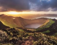 Azores - Sete Cidades Sunset Panoram. Photography by © (Jean Claude Castor) Probably the most iconic view on all of the Azorean islands the…