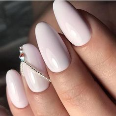 The Glossy White Nails. Keep your look simple with this white glossy nails and a simple stud on a single nail. #blacknails