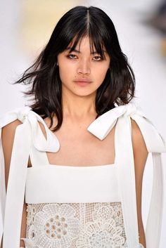There's something we'll always love about French-girl style. See how to emulate their iconic medium layered hairstyles with a fringe. | All Things Hair - From hair experts at Unilever