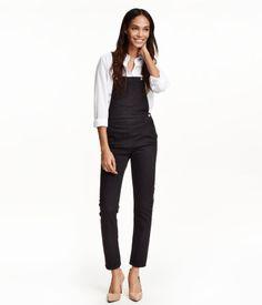 Overalls in washed stretch denim with adjustable suspenders. Bib pocket, side pockets, back pockets, buttons at sides, and slim legs.