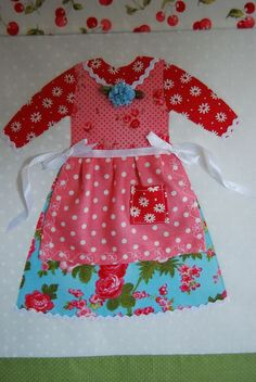 Doll Dresses Quilt... great way to remember with fabrics from favorite baby outfits.