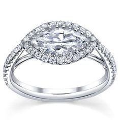 This is the ring for me!!! without the diamonds around the center diamond but keep the ones on the band... PERFECT!