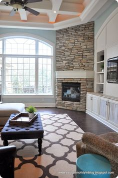 love this living room setup with the stacked stone fireplace and built ins with wide area for tv