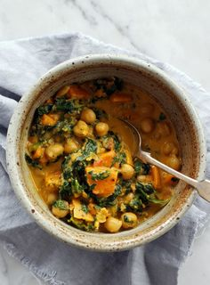 Sweet Potato, Chickpea and Spinach Curry   dish.co.nz   Full of nourishment and warming spices, this curry makes a big batch that will see you through a few chilly weeknights. Serve with steamed millet or quinoa.