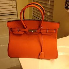Purse Beautiful real leather orange colored purse. Only carried once so it's in excellent condition. Has plenty of room to Carry just about anything. It's really a beautiful designer style purse without the designer price. Bags Totes
