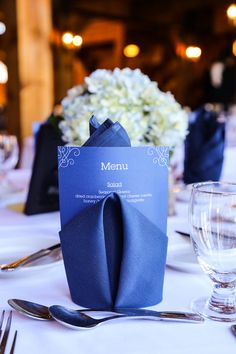 Classic navy blue and white wedding reception decor - navy blue napkins with dinner menus {One Eleven Images}