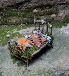 Fae Forest Bed Custom Order. 48.00 -  It boasts tall bedposts topped with acorn caps and measures 13 centimeters long (just slightly over 5 inches) x 9 cm. wide x 12.5 cm. high to the top of the headboard.