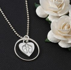 A beautiful way to show your eternal love. Eternity necklace with baby feet in heart charm. The circle is a 19mm sterling silver loop.  The standard chain is an 18 Sterling Silver ball chain. Please see my upgrade listing for longer chains or alternate styles: www.etsy.com/listing/188095645  If you would like to add a birthstone to this necklace, please see my other listing for an add-on birthstone or pearl charm.  By purchasing this item you acknowledge that you have read and agree to my…