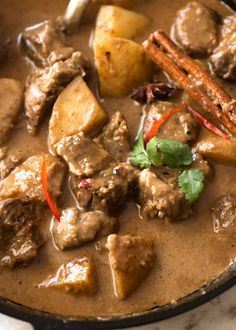 Close up of Massaman Curry in a black skillet, fresh off the stove Spicy Recipes, Curry Recipes, Indian Food Recipes, Asian Recipes, Beef Recipes, Ethnic Recipes, Indian Foods, Savoury Recipes, Dining