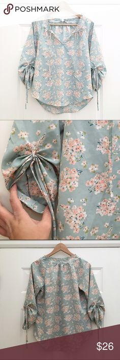 Lauren Conrad Floral Top The sweetest teal floral print top with tie strings at neck. The sleeves are 3/4 length but can be tied higher using the attached tie strings. EUC with no signs of wear. Tops Blouses