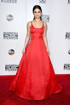 Selena Gomez went classic in a figure-hugging crimson gown, worn with a simple low ponytail and a smoky eye.