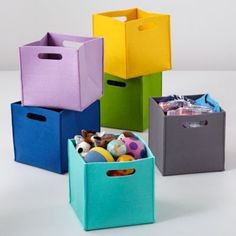 Cube bins (will work with Ikea Expedit shelves) - lots and lots of other styles, materials and colors (canvas, basket, plastic weave,  fabric with spots or stripes, etc.). Intended for kids but will work for anything.