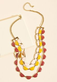We gather you here to express our enthusiasm over your newest outfit addition - this tiered necklace! With half-moon-shaped accents brightly boasting mustard, maroon, and petal pink enamel, this antiqued gold neckwear will earn you cheers anytime it's flaunted.