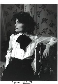 : A young Coco Chanel,  in a lovely white blouse, black skirt & neck scarf....1913
