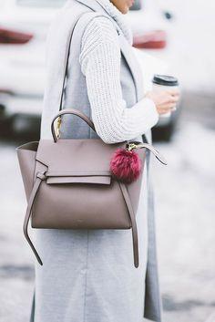 Neutral Bag, Pom Pom Keychain, Long Grey Vest, Grey Outfit, Céline. /thecoveteur/
