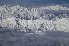 Teruhide Tomori posted a photo:  The Japan Alps mountains viewing from the airplane flying 9,200 meters.  Upper left : Mt. Tsurugi (2,999 meters)  Upper right : Mt.Kekachi (2,414 meters)  Lower left : Mt.Kashima-Yari (2,889 meters)  Lower middle : Mt.Goryu (2,814 meters)  Lower right : Mt.Karamatsu (2,696 meters)  9,200メートル上空から見た北アルプスの眺め  上左:剱岳と奥大日岳 (富山県)  上右:毛勝三山 (富山県)  中左:鹿島槍ヶ岳 (長野県)  中央:五竜岳 (長野県)  中右:唐松岳 (長野県)  雲海の下には信濃大町と白馬村があります。