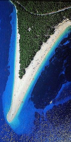 Spend the day at Zlatni Rat Beach in Croatia. This unique v-shaped beach changes shape with the wind and current of the Adriatic Sea.