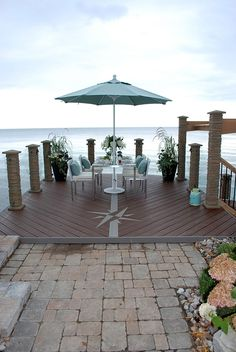 Waterfront designs on pinterest deck design nautical for Waterfront deck ideas