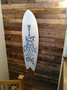 Recycled Twin fin surfboard on a Pallet wooden wall