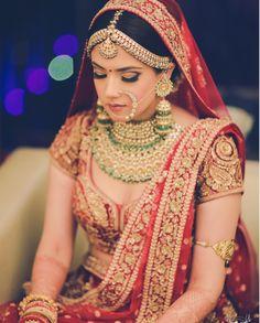 What an amazing bridal ensemble!  #jewellery #bridal #jewelry #bridaljewellery #indian #bride #wedding #nath #necklace #mathapatti #wedzo