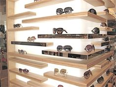 back lit retail display with plywood shelves, sunglasses