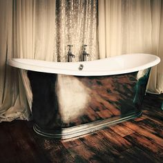 updated 'antique' cast iron style but in rust proof aluminum alloy with an enamel lining in any color ~ st. versatile tub by the bath works