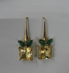 Gehna offer to showcasing Lemon topaz and green emeralds feature in this pair of earrings handcrafted in 18k gold online in Chennai.