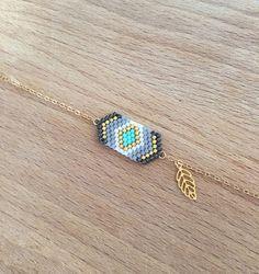 Bracelet fin tissage géométrique  Composé d'un ensemble de perles miyuki tissées 2,5cmx1,2cm  Couleurs: Noir Métal, Doré, Gris, Turquoise, Blanc Petite feuille en plaqué  - 16609148
