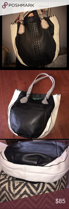 OrYany Lyssie Bag Say- Hello to this gorgeous orYany bag in Black, White and Gray with Subtle embellishments. I used this bag twice and there isn't any stains or smells. Material: Pebbled leather and interior cotton. Interior has 2 zippered pockets and 2 open walled pockets. orYany Bags Shoulder Bags