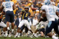 2008 Meineke Car Care Bowl: WVU 31 UNC 30... Pat White became the first player in NCAA history to win four bowl games as a starting quarterback.