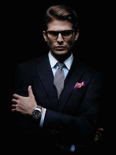 Suit. Squared glasses. Handkerchief.