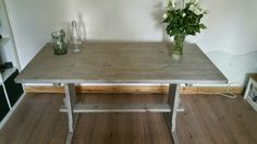 Lime waxed wooden refectory table.