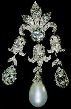 '' Women of Hampshire''  Brooch - Diamond and pearl brooch, which was originally intended to be used as a pendant, was Queen Mary's wedding gift from the Women of Hampshire in 1893. A committee chaired by the Duchess of Wellington bought from Garrard. The piece features a large brilliant with a foliate spray above and three bell flower pendants below  and Two pear-shaped diamonds and one baroque pearl hang  from the flowers all removable.