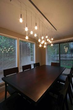 Dining room green curtains blue glass chandelier high back dining ...