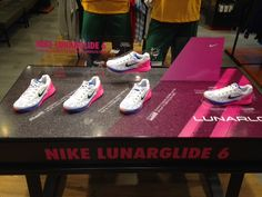 Nike Lunarglide 6 sports shoe retail table display.