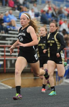 TIMES-REPORTER PAT BURK Micah Donley of Carrollton wins the 100 meter dash during the Division II district meet Saturday at West Holmes.