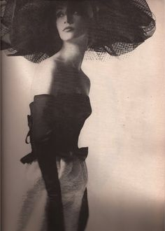 "Note that her ""opera gloves"" hit above the elbow...at the exact height of her sweetheart dress bodice...superb tailoring....photography by Melvin Sokolsky"