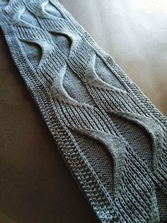 Knitting Pattern for Underlying Structures Long Cowl - Cables and slipped stitches combine to form wavy helix-like motifs that give both visual movement, and dimensional texture.