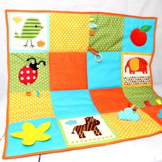 Cute sensory play mat to keep baby busy #babyactivity #quilts #babyplay #padding #blanket