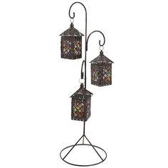 Handsomely handcrafted caravan lanterns are suspended from a gracefully wrought metal stand to create an effect at once welcoming and exotic. Stationed near a doorway or positioned as a centerpiece, this lantern tells guests they're going somewhere special.