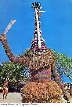 Africa | Makishi dancers at Livingstone, Zambia || Postcard; dated 1969.