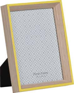 A natural wood frame with aqua rim hangs on wall or props on stand. Suitable full framed for 4 x 6 photos.