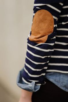 Elbow pads on sweater over a chambray denim shirt.