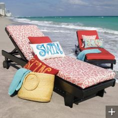 Darling way to sun using a chaise with pillow that spells SWIM.