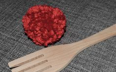 Pom pom made with a wooden fork.